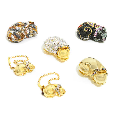 A collection of 4 sleeping cat pillboxes together with two sleeping cat keychains,