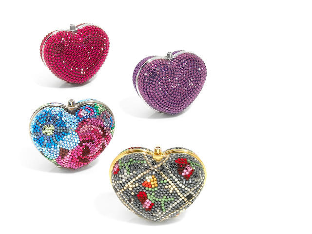 A collection of 4 heart shaped pillboxes,