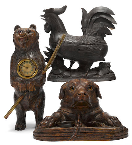 A Black Forest lindenwood bear clock, hound humidor, and carved chicken box late 19th/early 20th century