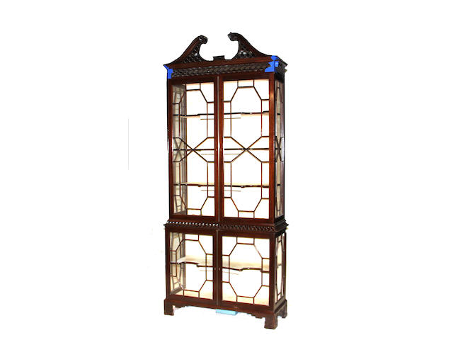 A pair of George III style carved mahogany display cabinets