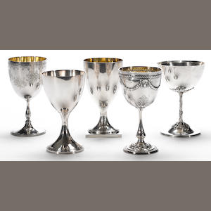 A George III and Victorian silver and plated group of five goblets