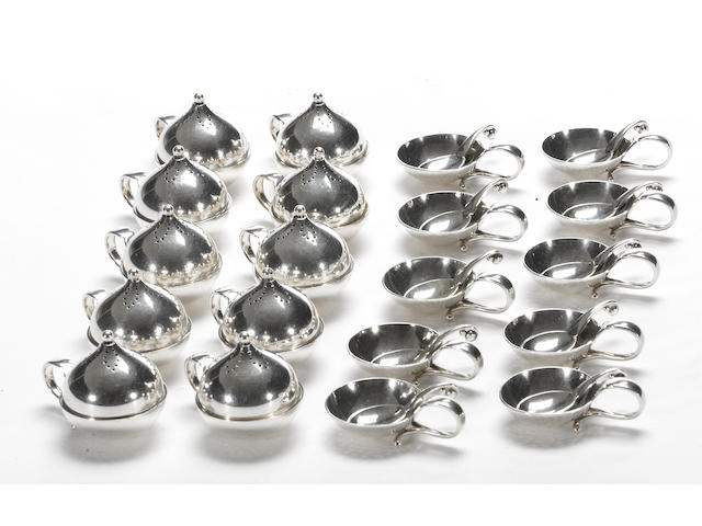A Danish sterling set of individual condiment settings for ten Georg Jensen, Copenhagen, post 1945  #s 119, 667 and 110