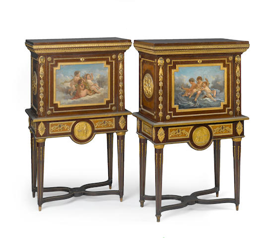 A pair of Louis XVI style gilt bronze mounted and paint decorated small cabinets (painted scenes on door)<br> fourth quarter 19th century