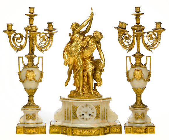A French [Napoleon III] gilt bronze and onyx figural three-piece clock garniture  <br>figural group after model Claude Michel Clodion (French, 1738-1814) and cast by Barbier foundry<br>plinth and candleabra by Henri Picard, Paris<br> third quarter 19th century