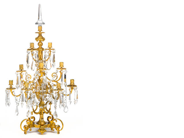A Louis XVI style gilt bronze and cut glass nine light girandole