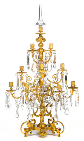 A Louis XVI style gilt bronze and cut glass nine light girandole late 19th century