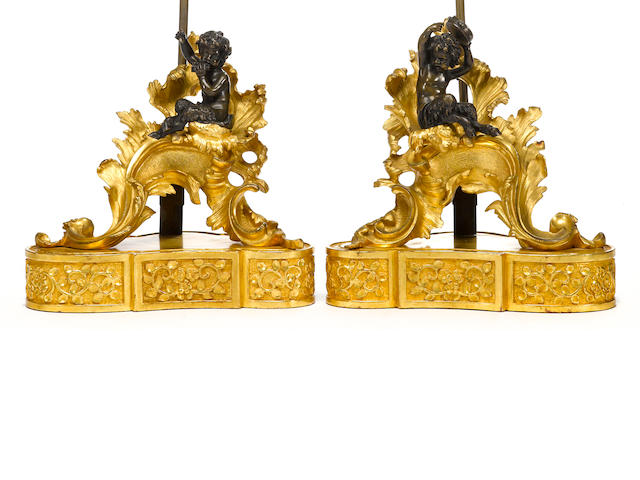 A pair of Louis XV style gilt and patinated bronze figural chenets, now mounted as table lamps <br>late 19th century