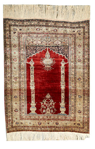 A Silk Tabriz rug Northwest Persia size approximately 5ft. 5in. x 4ft. 2in.