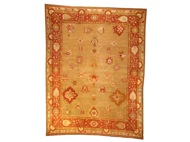 An Oushak carpet West Anatolia size approximately 10ft. 2in. x 13ft. 2in.