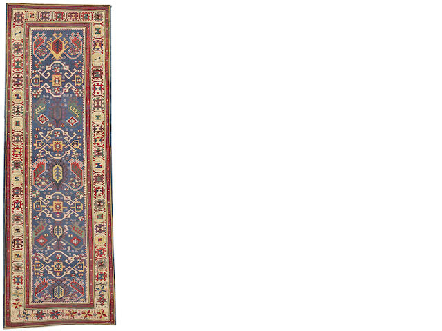 A Kuba Runner Caucasus size approximately 3ft. 1in. x 9ft. 1in.