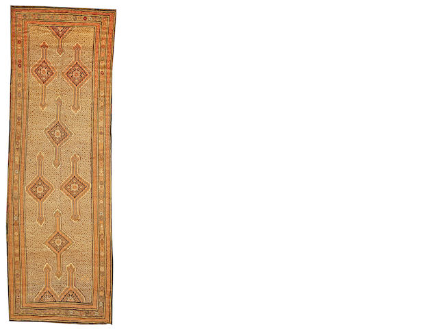 A Serab long carpet Northwest Persia size approximately 4ft. 7in, x 12ft. 10in.