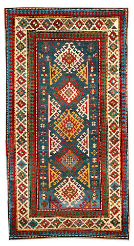 A Kazak rug Caucasus size approximately 4ft. 2in. x 7ft. 8in.