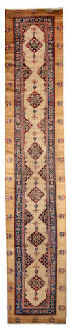 A Serab runner Northwest Persia size approximately 3ft. 6in. x 18ft. 6in.