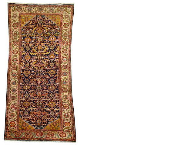 A Sultanabad long carpet Central Persia size approximately 5ft. 9in. x 11ft. 3in.