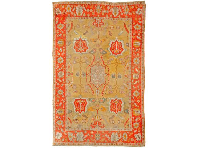 An Oushak carpet West Anatolia size approximately 10ft. x 13ft.