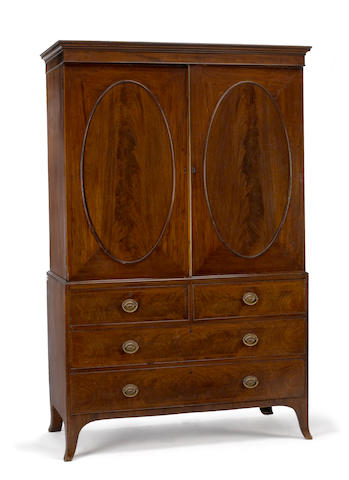 A George III inlaid mahogany linen press early 19th century