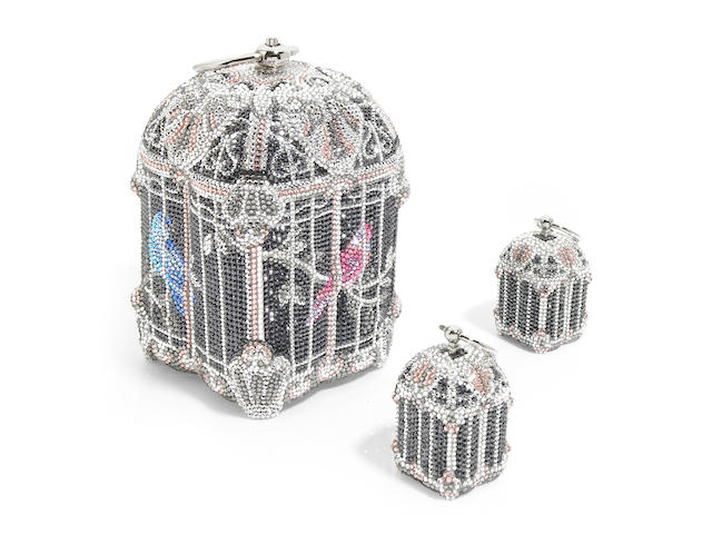 A black, silver and pink crystal nightingale birdcage minaudiere with two birdcage pillboxes,