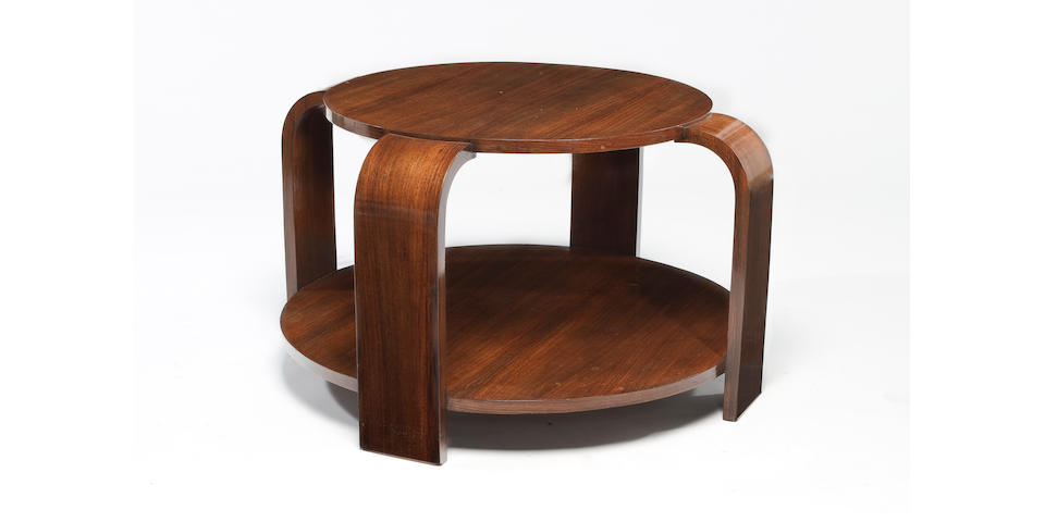 A Louis Sognot two-tier mahogany table