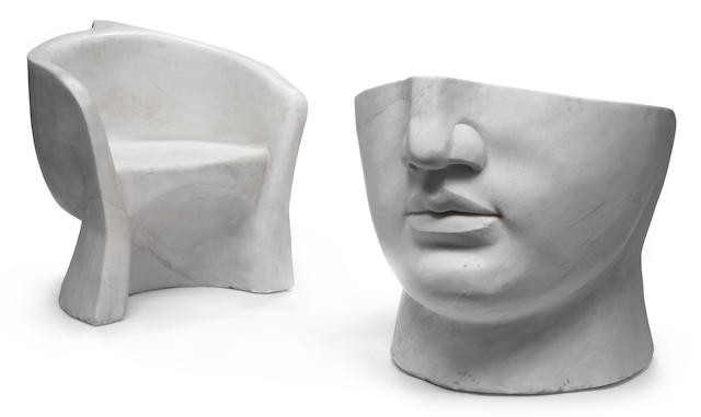 A pair of Surrealist style carved marble chairs