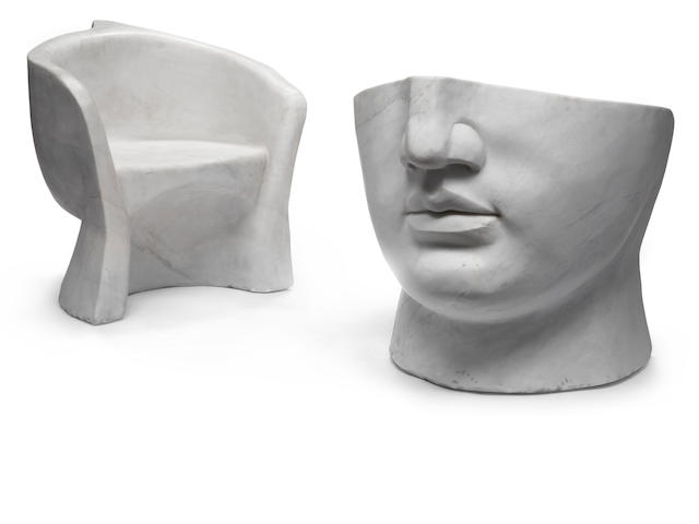 A pair of Surrealist carved marble chairs