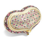 A heart shaped multi-colored crystal purse with flower and diamond geometric motifs and white bead detailing,