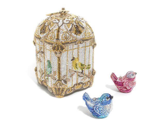 A silver and gold birdcage purse together with one pink and one blue bird pillbox,