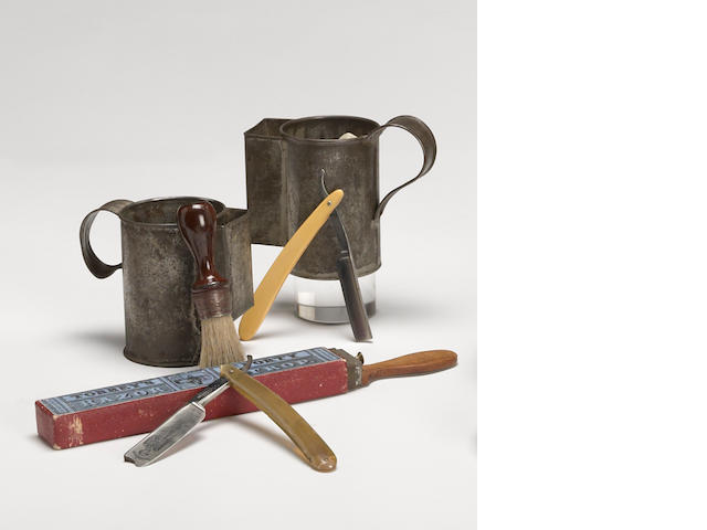A Civil War era shaving group: two tin mugs, strop, brush, two razors
