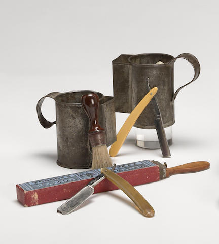 A Civil War era shaving group: two tin mugs, strop, brush, two razors