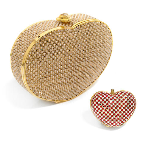 A heart-shaped gold crystal and white bead purse together with a red and silver crystal heart-shaped pillbox,