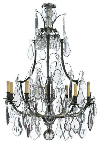 A Louis XV style glass and patinated bronze nine light chandelier late 19th century
