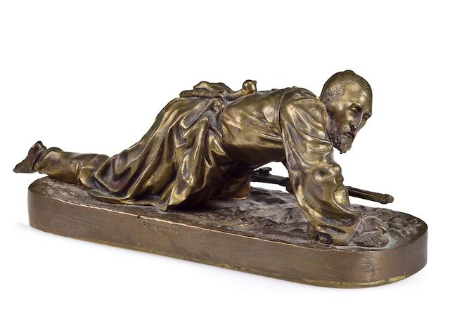 A bronze figure of a crawling cherkess inscribed in Cyrillic E. Lanceray/1871, with Chopin Foundry mark and date 1871, retailed by Tiffany and Co.<br>