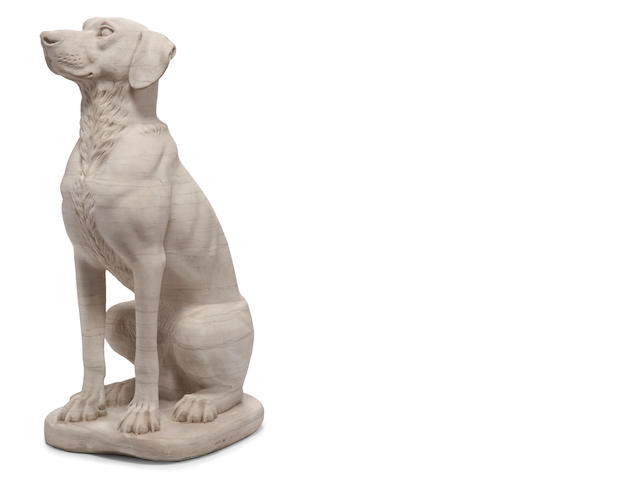 A carved white marble figure of a hound
