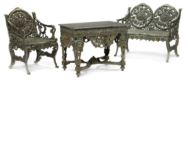 A suite a Victorian style painted cast iron garden furniture