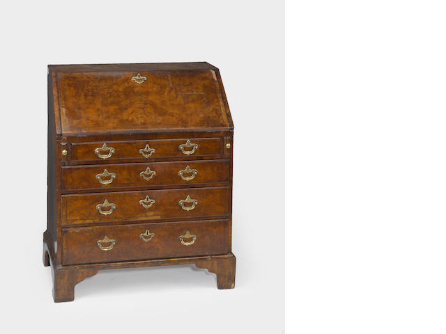 A George II feather banded walnut slant front desk<br>second quarter 18th century