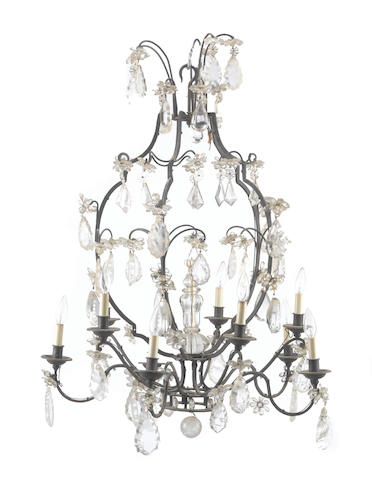A Continental Rococo style patinated metal, rock crystal, and glass ten light chandelier late 19th century