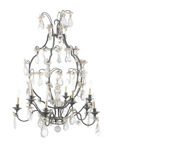 A Rococo style patinated metal, rock crystal, and glass ten light chandelier