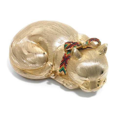 A gold colored metal sleeping cat purse with a crystal plaid bow collar,