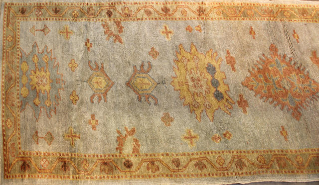 An Oushak runner size approximately 2ft. 11in. x 12ft. 11in.