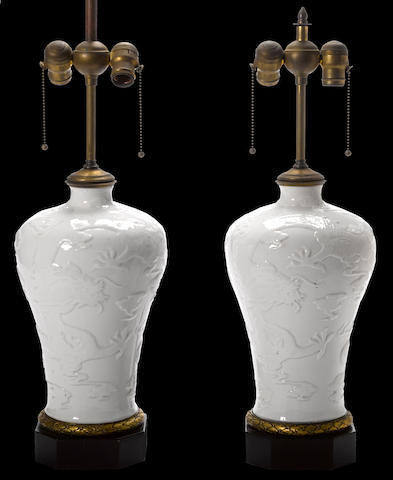 A pair of Chinese style gilt bronze mounted white glazed porcelain vases, now mounted as table lamps late 19th/early 20th century