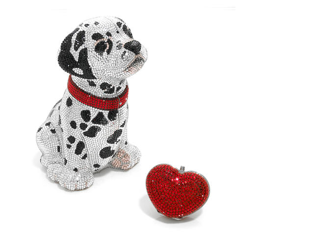 A dalmatian dog purse together with a red heart pillbox,