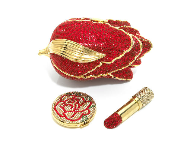 "A red tulip purse together with a gold and red ""lipstick"" lipstick container and a flower compact,"