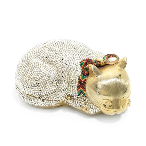 A silver crystal sleeping cat purse with a plaid crystal collar,
