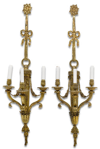 A pair of Louis XVI style gilt bronze three light bras de lumière<br>early 20th century