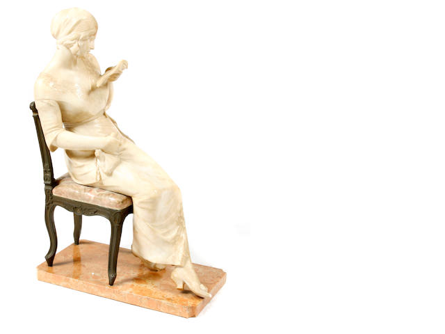 An Italian mixed alabaster and bronze figure of a woman reading