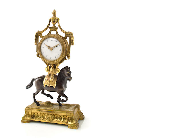 A small Louis XVI ormolu and patinated bronze timepieceThe movement signed, Petite à Paris, no. 261, late 18th century.