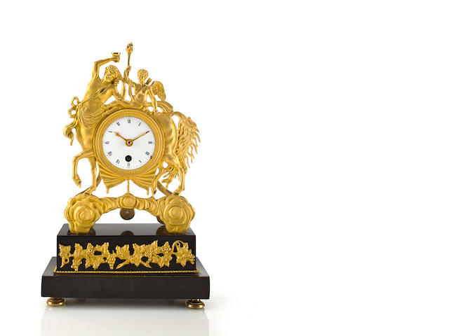 An Empire ormolu and black marble mantel timepieceFrench, circa 1810.