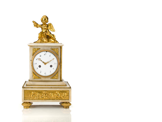 Louis XVI style ormolu and white marble mantel clock surmounted with a cherub