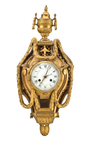 A Continental neoclassical ormolu striking and hour repeating small cartel with calendarProbably Swiss, last quarter 18th century