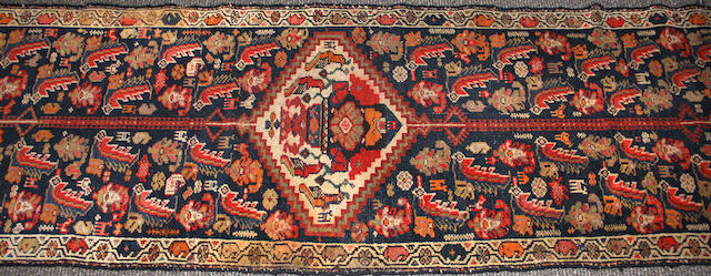 A Kurdish Runner size approximately 2ft. 4in. x 13ft. 2in.
