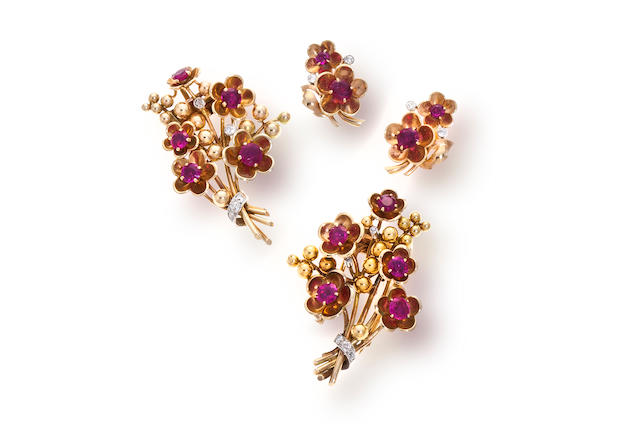 Two retro ruby, diamond and fourteen karat gold brooches and pair of earrings,